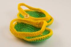 Butins jaunes et verts images stock