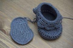 Butins tricotés de chéri Photographie stock libre de droits