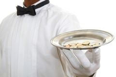 Butler. Image of a butler with a plate of money just for you royalty free stock photography