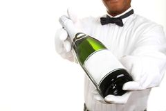 Butler. Image of a butler with a bottle of champagne just for you royalty free stock image