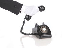Butler answering phone Royalty Free Stock Images