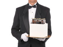 Butler with Beer on Tray Stock Image