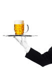 Butler with beer on tray Royalty Free Stock Photo