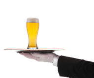 Butler with Beer and tray on outstretched arm Stock Photography