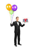 Butler carrying a tray and balloon Stock Photos