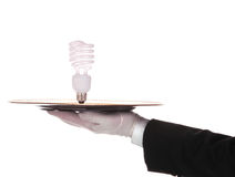 Butler with Compact fluorescent bulb on tray Stock Photos