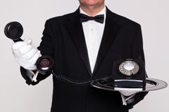 Free Butler Handing You A Telephone Royalty Free Stock Photos - 29082818