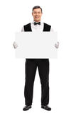 Butler holding a bank white signboard royalty free stock images