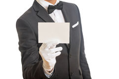 Butler holding a blank card stock photo