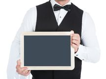Butler holding blank slate Royalty Free Stock Photos