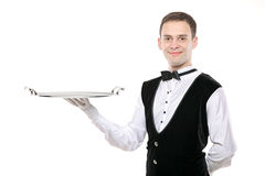 Butler holding an empty silver tray. A butler holding an empty silver tray isolated on white background royalty free stock photos