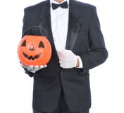 Butler Holding Plastic Pumpkin Royalty Free Stock Photography