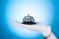 Butler Holding Service Bell Stock Photos