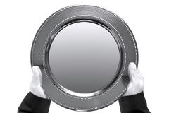 Butler holding a silver tray. Photo of a silver tray being held by a butler, shot from above and isolated on a white background Stock Photography