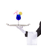 A butler holding a silver tray with cocktail on it. Isolated on white stock image