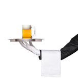 Butler holding a tray with a beer glass on it Royalty Free Stock Photo