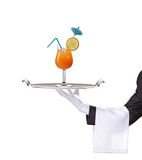 A butler holding a tray with cocktail on it Royalty Free Stock Image