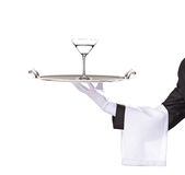 A butler holding a tray with cocktail on it. Isolated on white stock image
