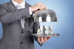 Butler holding tray and paper people Stock Photography