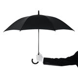 Butler holding an umbrella Stock Photo
