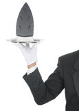 Butler with Iron on Tray Stock Image