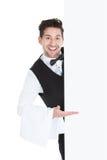 Butler looking at blank billboard Royalty Free Stock Photos