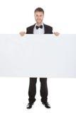 Butler Looking At Blank Billboard Royalty Free Stock Photo