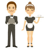 Butler And Maid Serving. Butler holding silver tray and maid serving coffee Stock Photo