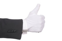Butler making thumbs up gesture Stock Photography