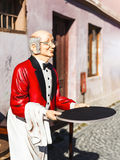 Butler man statue with tray. Serving customers stock photo