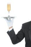 Butler mit Champagne auf Tellersegment Stockfotos
