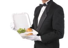 Butler mit Take-out Nahrungsmittelbehälter Lizenzfreie Stockfotos