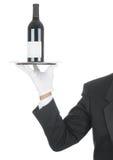 Butler mit Wein-Flasche auf Tellersegment Stockfotos