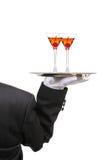 Butler mit Wein-Gläsern auf Tellersegment Stockbild