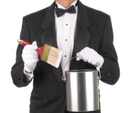 Butler with Paint Can and Brush. Butler wearing a tuxedo holding a Paint can and Brush isolated on white. Square format showing only the persons torso royalty free stock photos