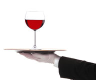Butler with Red Wine Glass on Tray Royalty Free Stock Photo