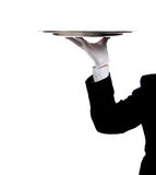 A butler's gloved hand holding a silver tray Royalty Free Stock Image
