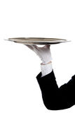 A butler's gloved hand holding a silver tray Royalty Free Stock Photography