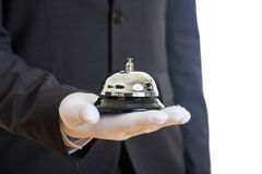 Butler service bell in a gloved hand Stock Photos