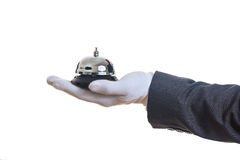 Butler service bell in a gloved hand Royalty Free Stock Photos