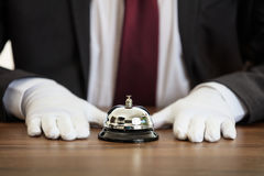 Butler service bell on a wooden desk Stock Image