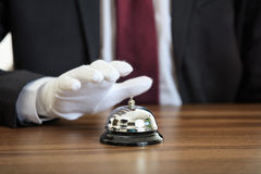 Butler service bell on a wooden desk Stock Images