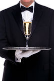 Butler serving a glass of champagne Royalty Free Stock Photo