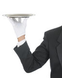 Butler with Tray. Butler wearing tuxedo and formal gloves holding a silver tray. Shoulder hand and arm only isolated on white vertical composition stock photos