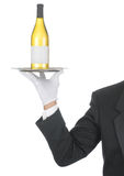Butler with Wine Bottle on Tray Royalty Free Stock Photography