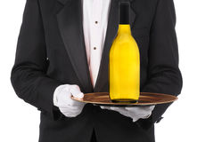 Butler with Wine Bottle on Tray Royalty Free Stock Photo