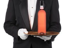 Butler with Wine Bottle on Tray stock photos