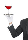 Butler with wine glass on Tray Royalty Free Stock Image