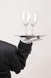 Butler with Wine Glasses on Tray Stock Image