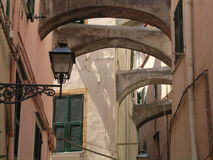 Butress Alley. A narrow alleyway in the old town of San Remo, Italy, with several butresses supporting the walls royalty free stock photos